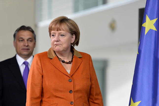 Angela Merkel with Viktor . AFP/Odd Andersen.