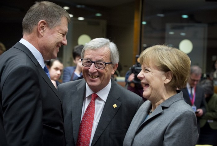 German Chancellor Merkel shares a light moment with Klaus Iohannis (left) President of Romania and Jean-Claude Juncker (middle) President of the European Commission