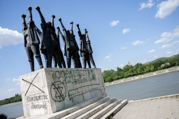 An example of a defaced Holocaust monument in Hungary, with graffiti from 2013. Photo: atv.hu