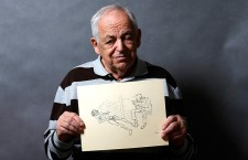 Lajos Erdélyi, an 87 Holocaust survivor, holds an illustration made by a campmate in Auschwitz. Photo: László Balogh/Reuters.