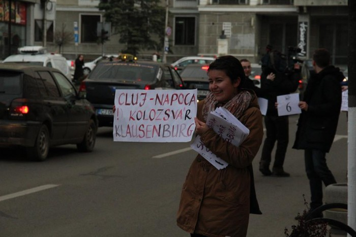 A Muszai-Muszáj activist holds up a sign at a flash mob in Cluj-Napoca. Photo: Facebook.