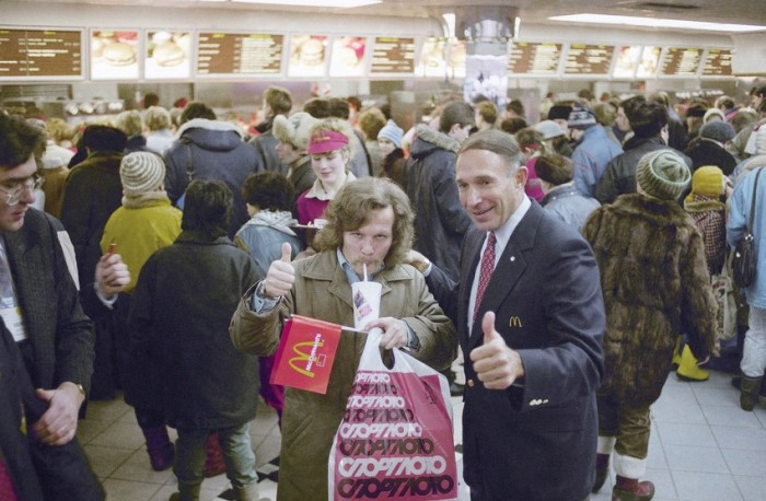 A flashback to 1990: A Russian customer at the first McDonald's in Moscow gives a thumbs up, standing alongside George Cohon, the chairman of McDonald's Canada. Photo: Rudi Blaha/Associated Press.