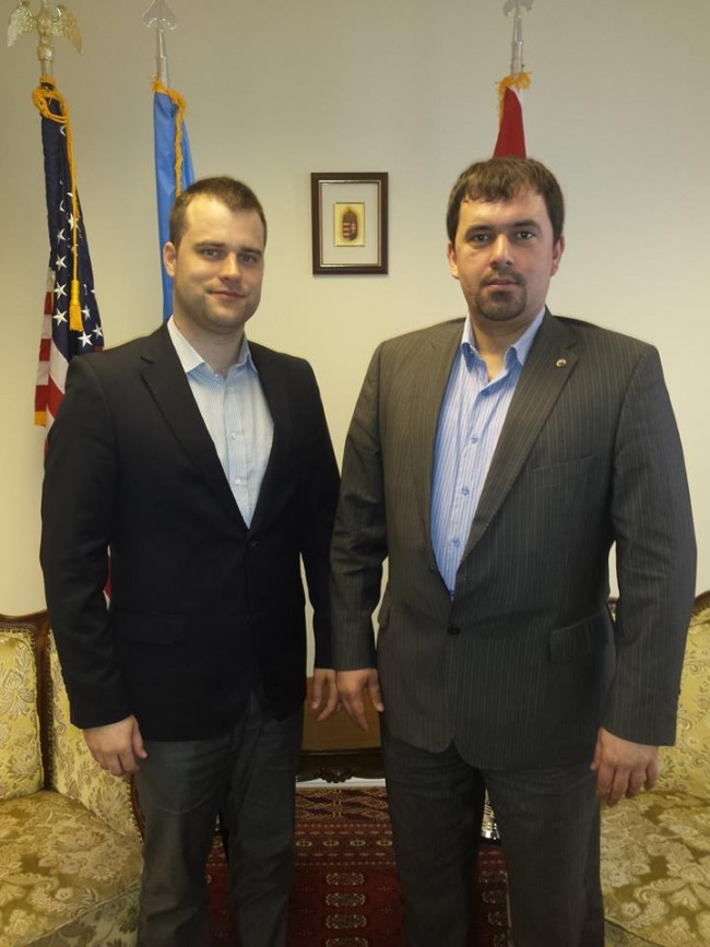 "Mr. Staudt and Mr. Szávay ""take a stand"" in Consul General Ferenc Kumin's offices. Photo: Facebook."