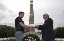 Alexei Galitsky of Night Volwes is greeted by Vladimir Szemidetko First Secretary of the Russian Embassy in Budapest.