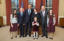 Ms. Szemerkényi with her family and President Obama in the Oval Office.