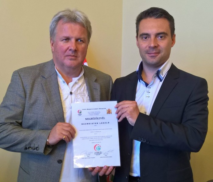 Mr. Baumeister (left) receives his accreditation from Jobbik Party Chairman Mr. Vona.