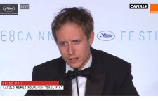 László Nemes accepts his award at the Cannes film festival.