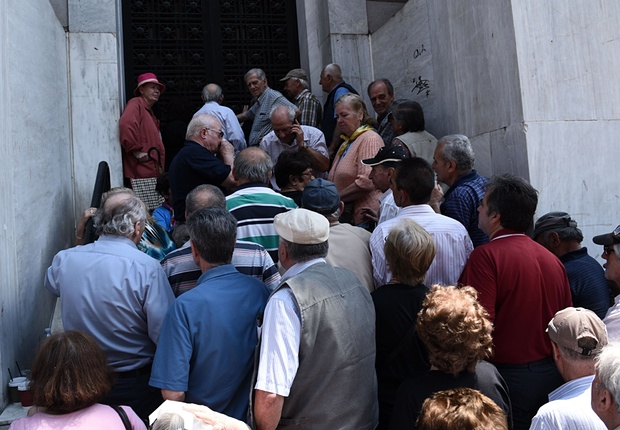 While Greece's bank are ordered to shut down for a full week, pensioners storm shuttered bank branches throughout the country, leading to scenes of chaos across the country. Photo: Giannis Papanikos/AP