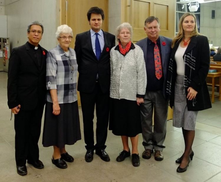 Father Brando Recana (left), two Sisters of Social Service and Ambassador Bálint Ódor (blue tie), filmmaker George Csicsery and Consul General Stefánia Szabó at St. Gabriel's Passionist Church.