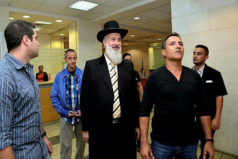 Chief Rabbi Yona Metzger arrested by plainclothes Israeli officers.