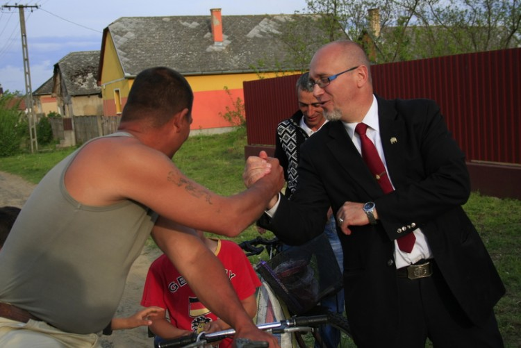 Mayor Orosz shares a friendly greeting and moment with local Roma.