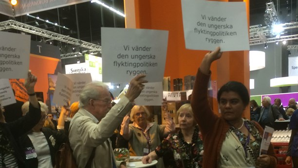 Audience protest against Hungary's policies at the 31st Göteborg Book Fair in Sweden.