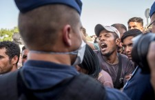 Tensions flare on September 19th, 2015, in the village of Beremend, on Hungary's border with Croatia, as over 5,000 refugees enter Hungary through its southern neighbour in the last 48 hours. On Friday, Hungarian authorities disarmed Croatian authorities and confiscated a train filled with refugees, with the Orbán government claiming that Croatia has violated Hungary's borders. Photo: Balázs Mohai/MTI.