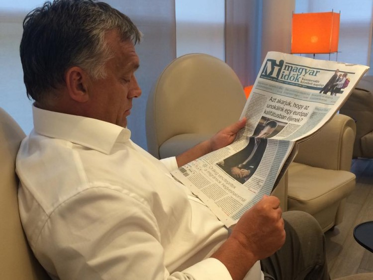 Mr. Orbán reads the cover page of the pro-government Magyar Idők daily, which features a headline warning readers about the risks of Hungary turning into an Islamic caliphate.