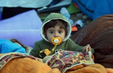 A Syrian child sleeping out in the open, at Röszke, one of the main refugee transit points in Hungary. Photo: NL Café.