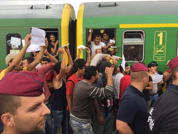 Syrian refugees being removed from the train in Bicske, 40 km west of Budapest. Photo: James Mates.