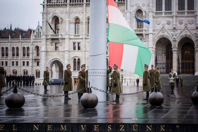 The ceremonial guard position Hungary's flag at half mast in front of Parliament, on the national day of mourning. Photo: Facebook.