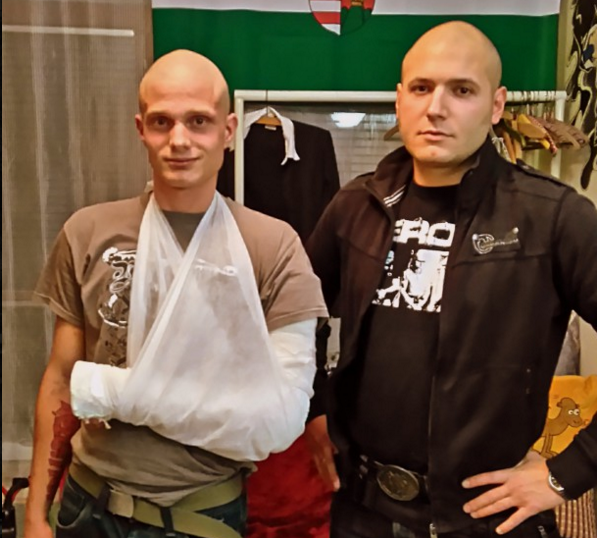 The victim of the attack in Kőbánya (left) standing with another skinhead, who happens to be Béla Incze, vice president of the Sixty-Four Counties Youth Movement.