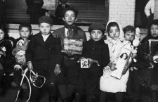 Children with Christmas tree and presents at Ellis Island in the early 1900s