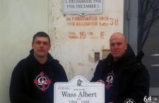 István Beke and Zoltán Szőcs, replacing a street sign with one bearing the name of World War II convicted war criminal, Albert Wass.