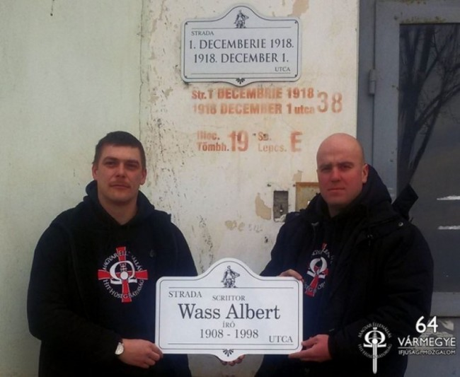 István Beke and Zoltán Szőcs, replacing a street sign with one bearing the name of World War II convicted war criminal, Albert Wass.