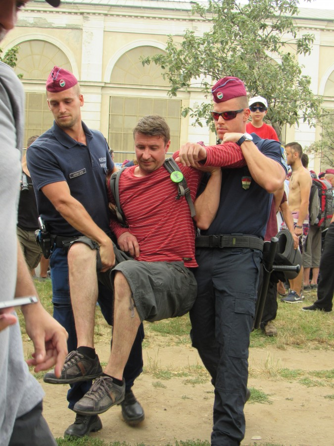 Police carry away a pro-democracy demonstrator. Photo: C. Adam.
