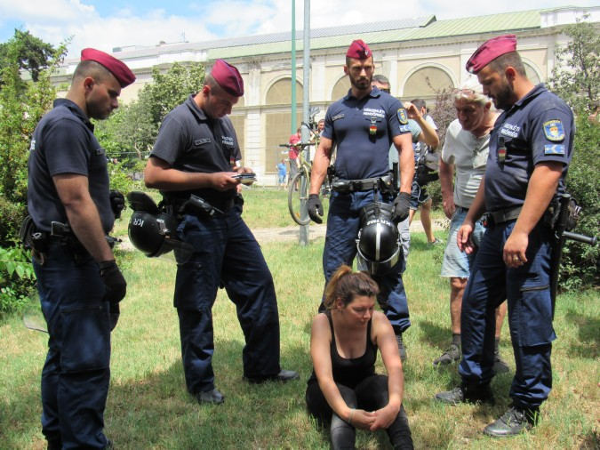 A demonstrator is removed by police. Photo: C. Adam