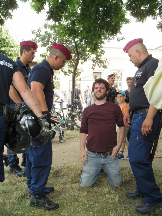A demonstrator is taken down by police. Photo: C. Adam