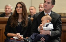 Máté Kocsis, with his wife, at his son's christening...one of many family pictures that Mayor Kocsis shares on Facebook.