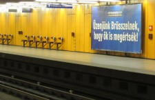 "Government campaign billboard in a Budapest metro station: Let's send a message to Brussels, so that even they will undertand!"" Photo: Christopher Adam."