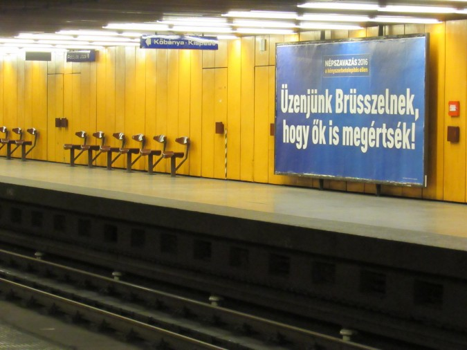 """Government campaign billboard in a Budapest metro station: Let's send a message to Brussels, so that even they will undertand!"""" Photo: Christopher Adam."""