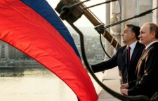 Vladimir Putin visits Viktor Orbán in Budapest, but the sizeable Russian flag blocks the view of the Hungarian capital.