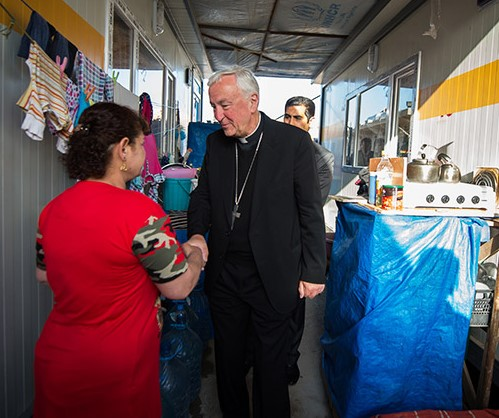 Cardinal Nichols visits a refugee camp in Iraq.