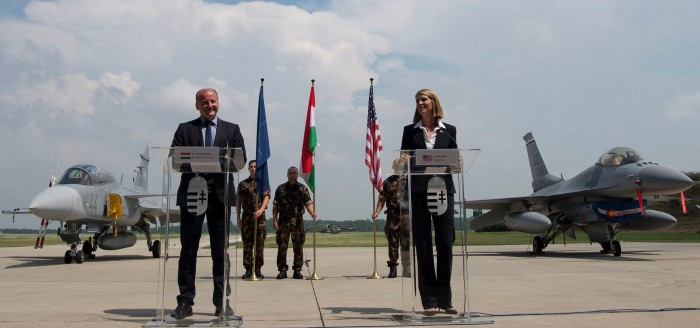 Mr. István Simicskó, Hungarian Defense Minister greets US NATO soldiers at Pápa Air Base with US Ambassador Ms. Colleen Bell.
