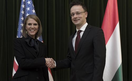 Mr. Péter Szijjártó, Hungary's Foreign Minister and US Ambassador Ms. Colleen Bell.  Mr. Szijjártó would send NATO soldiers home.