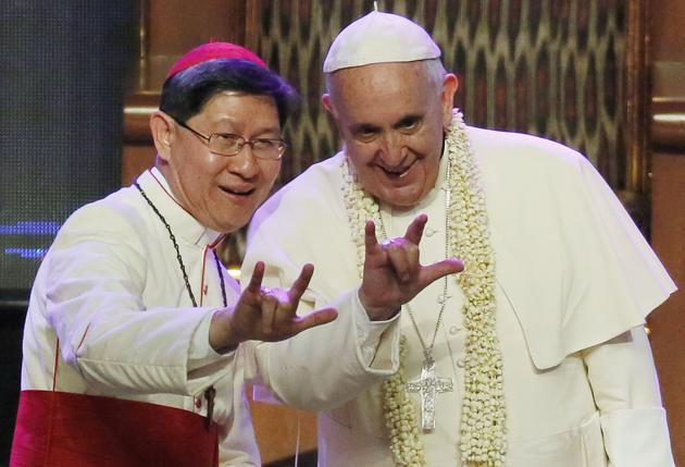 Cardinal Tagle and Pope Francis.  Tagle's grandparents were refugees from China.