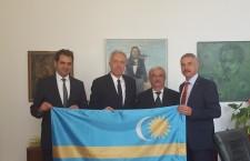 Mayor Antal (far left) and US Ambassador Klemm (next to him) are posing with the Szekler Flag.
