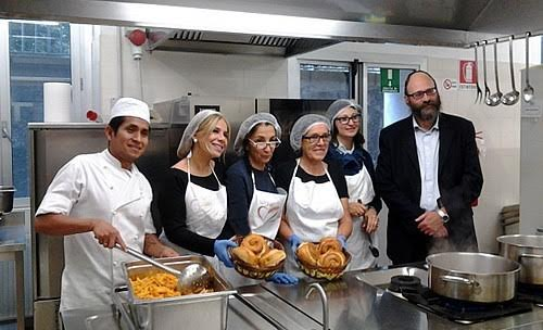 Chabad Rabbi Yigal Hazan in Milan, Italy with his kitchen staff.