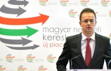 Minister of Foreign Affairs Péter Szijjártó, standing in front of the banner of the Hungarian National Trading House.