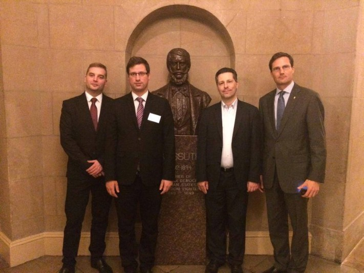 Mr. Tamás Harangozó (MSZP), Mr. Gergely Gulyás (Fidesz), Mr. András Schiffer (LMP), and Mr. Márton Gyöngyösi (Jobbik) at the Kossuth statue in the US Congress building.