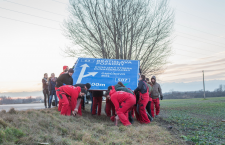 Activists plant a bilingual road sign in southern Slovakia. Photo: ketnyelvu.info