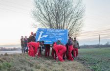 Activists plant a bilingual road sign in southern Slovakia. Photo: ketnyelvu.info