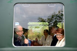 Ms. Grässle (right) smiles as she rides Mr. Orbán's vintage train.