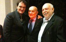 Tarantino wearing the Cross with Hungarian film representative Béla Bunyik and his wife Bonnie.