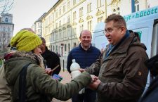 István Bajkai distributes free milk in 2018.
