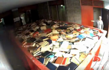 Two thousand Hungarian books were tossed into this container at the Foyer Hongrois in Montreal, before being taken away to be destroyed. The Foyer has eliminated its entire library.