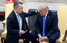 Pastor Bunson prays with President Trump in the White House.