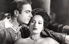 Romantic lead with his regular co-star, the exotic beauty Merle Oberon.