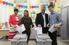 Klára Dobrev (left) and Ferenc Gyurcsány (right) cast their ballots on Sunday, with their family.