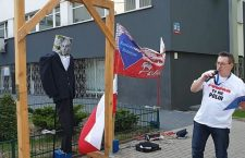 Polish nationalist activist Sławomir Dul hangs an effigy of late communist politician Jakub Berman, captioned 'Jew,' in Lodz on April 30. 2019